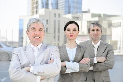 074e2454654 Portrait of three business people outside. Tout comité d entreprise ...